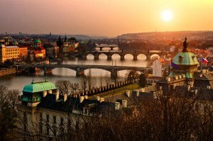 Panoramic view on Charles bridge and sunset Prague lights. Bohemia, Czech Republic