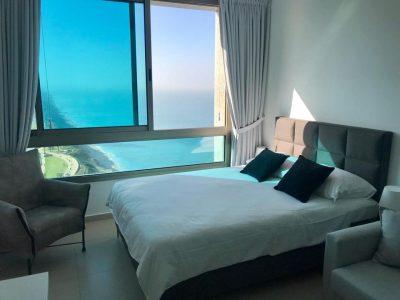 Стильная квартира-студио с панорамным видом на побережье